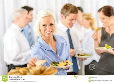smiling business woman during company lunch buffet royalty