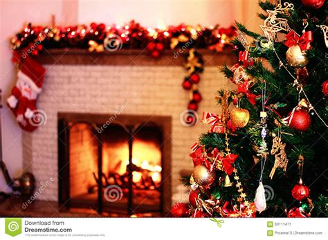 christmas tree in a festive decoration with a fireplace in