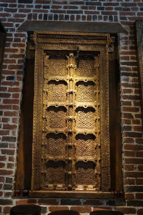 Antique hand carved double door with original brass & iron