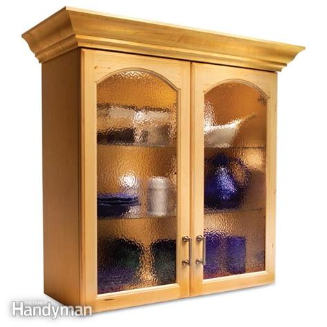 wood and glass kitchen cabinets convert wood cabinet doors to glass the family handyman