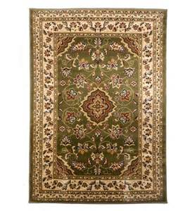 traditional style woven rugs and runners in green