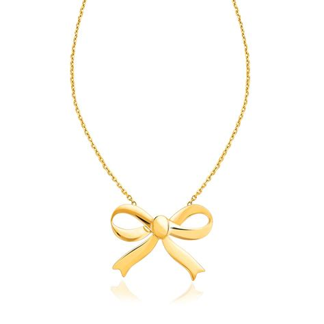 bow necklace in 14k yellow gold richard cannon jewelry