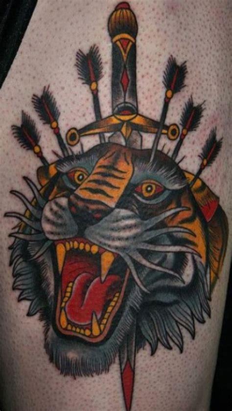 tattoo old school leone coloured tiger head pierced by a dagger and arrows tattoo