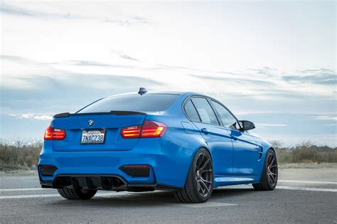 yas marina blue bmw m3 with vorsteiner aero and wheels