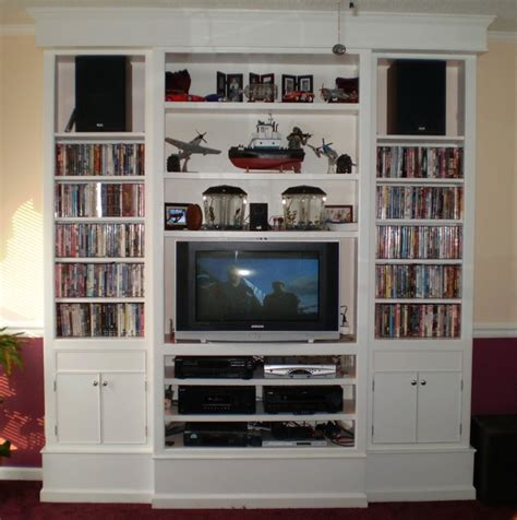 built in entertainment center book shelves by michael