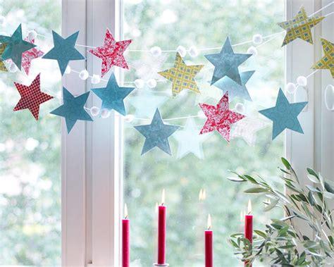 weihnachtsdekoration fenster selber machen weihnachtsdeko stimmungsvolle dekoideen girlande aus