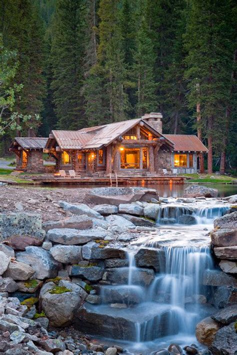 house with waterfall mountain stone house with waterfall