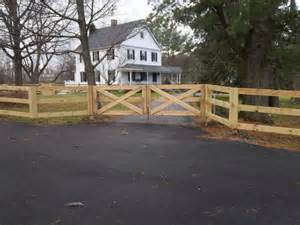 3 rail paddock style fence with driveway gate all