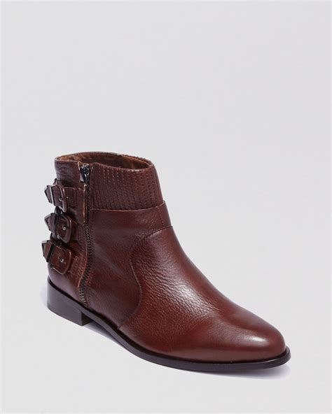 Dolce Vita Bone Sheep Buckle Boots by Dolce Vita Booties Ralphy Buckle Flat In Brown Chocolate
