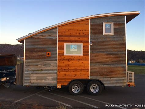 the durango tiny house on wheels is a minimalist traveler curved roof tiny house tiny house swoon