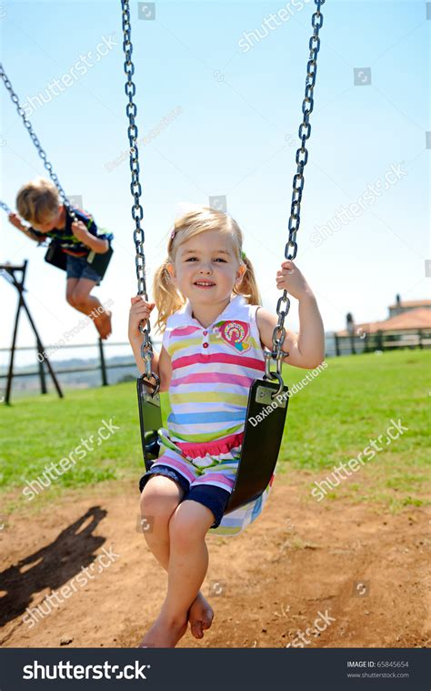 young swing young child on swing playground outdoors stock photo