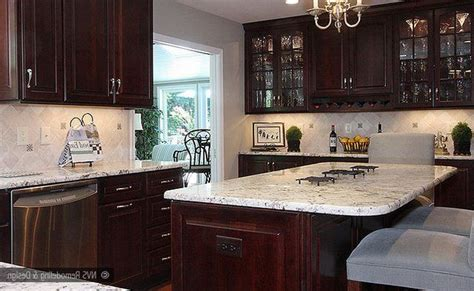 cherry cabinets with white granite colonial white granite countertop and island top with