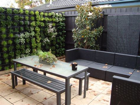 5 backyard design ideas for yards without grass