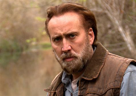 review nicolas cage in fine gritty form as a hard living watch nicolas cage holds venomous snake in scene