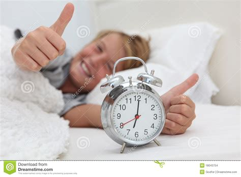 kid with alarm clock stock photo image of waking boys 18043754