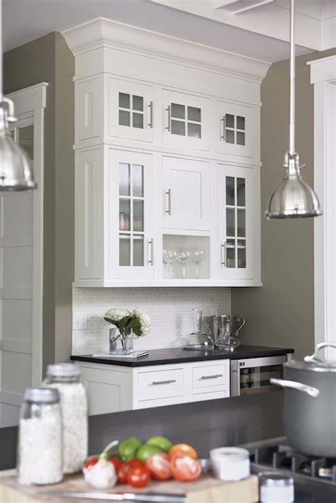 white kitchen cabinets wall color mini yoke pendants transitional kitchen sherwin