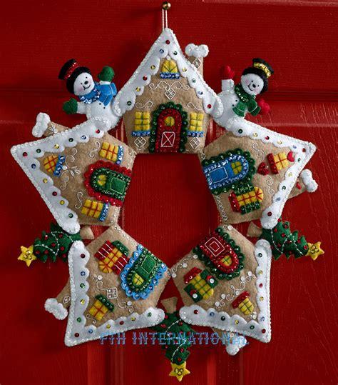 christmas on pinterest gingerbread houses garlands and bucilla gingerbread wreath felt christmas home decor kit