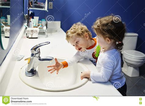 boy and girl in the bathroom closeup portrait of twins kids toddler boy girl in