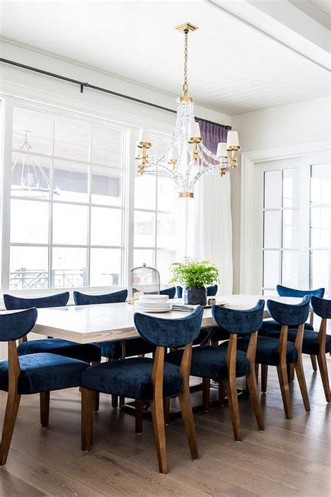blue wood dining chairs monochromatic dining room transitional dining room