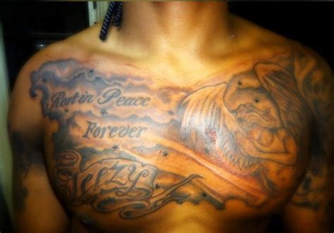rip chest tattoos 40 astounding rip tattoos creativefan