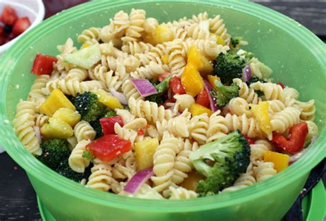 rotini pasta salad with broccoli florets and bell peppers