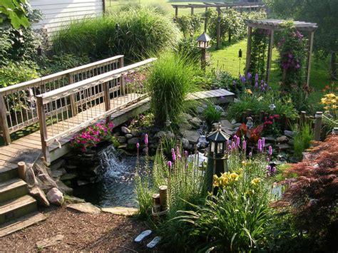 yard bridges backyard with peaceful pond hgtv