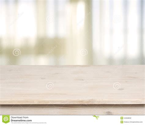 Free Dining Room Table Plans wooden table on defocuced window with curtain background