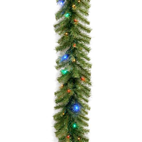 image lighted garland above white 9 ft battery operated artificial poinsettia garland with
