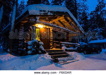 lapland log cabin snow covered log cabin finland lapland stock photo