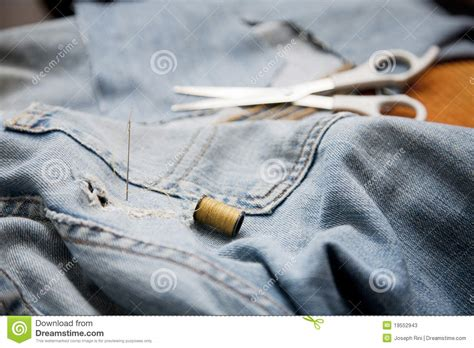 Upholstery Thread And Needle by Needle And Thread Stock Photos Image 19552943