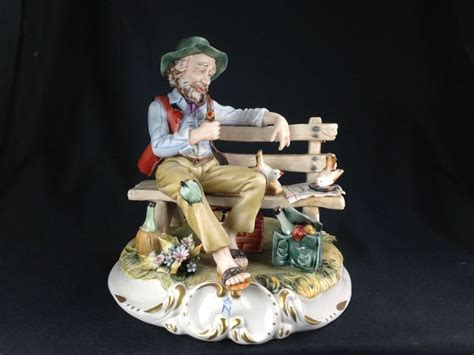 capodimonte man on bench vintage large capodimonte porcelain figure man feeding