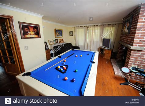 pool table in a room in a home uk stock photo