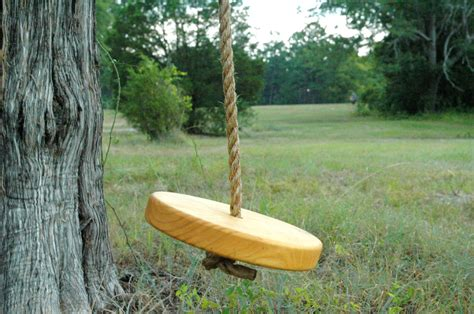 tree swing kids round shaped and yellow color used one rope for hanging on
