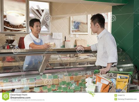 sales clerk assisting at the deli counter beijing stock image image 31693773