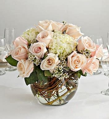 wedding centerpiece in glass bubble bowl with peach roses