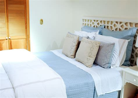 how to style a bed styling your bed a guide to duvets shams and quilts