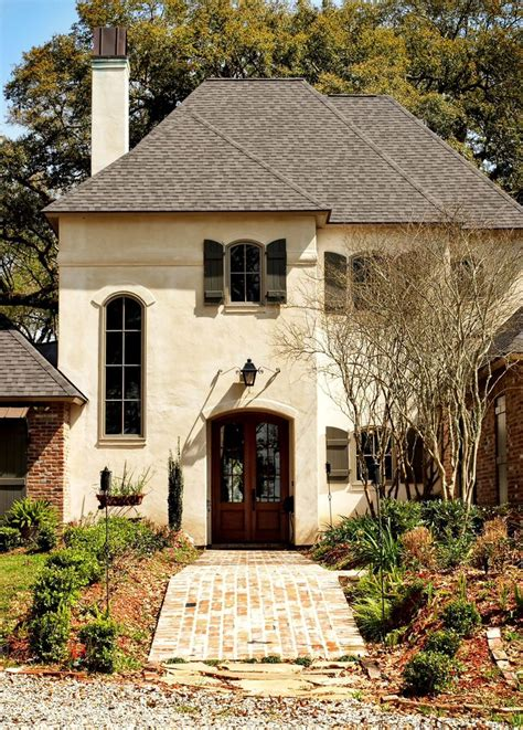 french country exterior yes creamy stucco color reddish brown brick and door