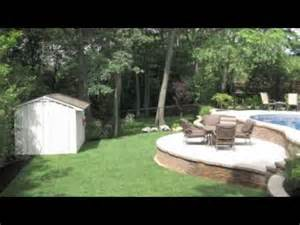 building a patio on a sloped yard swimming pools built on sloped yards travertine