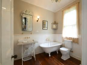 provincial bathroom design with claw foot bath
