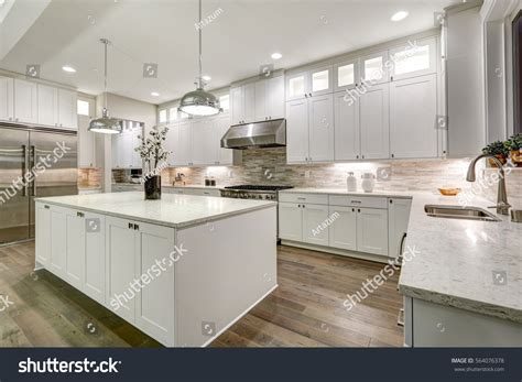 marble subway tile kitchen backsplash with feature time gourmet kitchen features white shaker cabinets stock photo