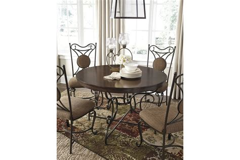 brown dining room table brulind round dining room table in brown by ashley d