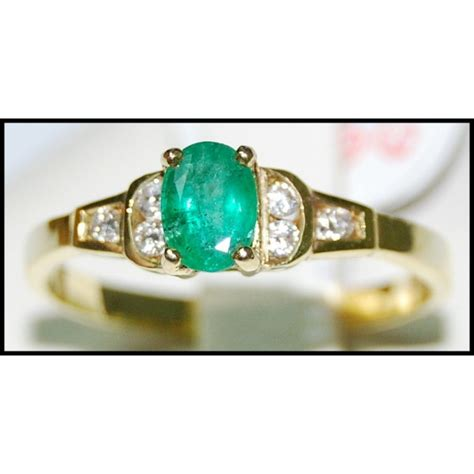 wedding solitaire emerald 18k yellow gold ring
