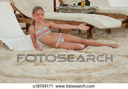 stock photography of a young girl (13 14) wearing a bikini