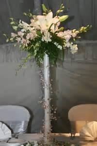 White Eiffel Tower Vase A Beach Inspired Wedding Centerpiece Features A White