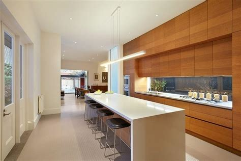 renovated homes modern kitchen counter bench top high ceilings timber floors white kitchen