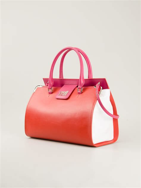 Roberto Cavallis Has Packed Bags by Lyst Class Roberto Cavalli Small Bowling Bag In Orange