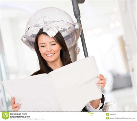 Hair Dresser Reading by Dying Hair Royalty Free Stock Photo Image 30624235