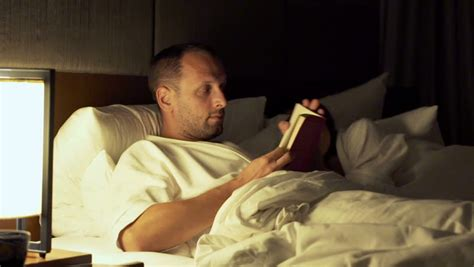 how to read a book in bed young woman reading book lying on bed late at night at