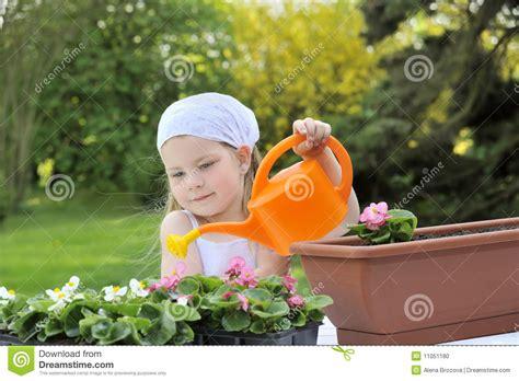 girl watering flowers little girl watering flowers stock photo image 11051180