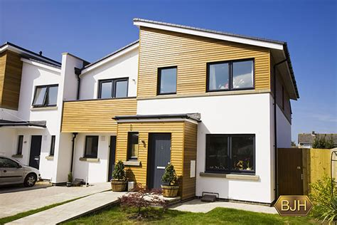 full view contemporary modern wood clad home  grey